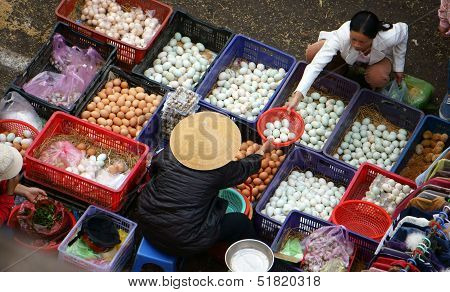 People buy and sell hen eggs, duck eggs  at open air market