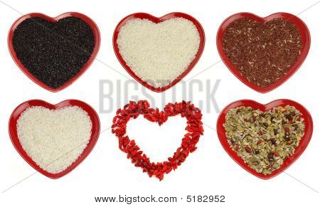 Different Sort Of Rice And Goji Berryes Heart Shape Isolated