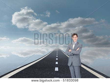 Composite image of assertive businessman standing on street floating in the sky