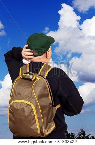 Man Tourist On A Background Of The Sky.