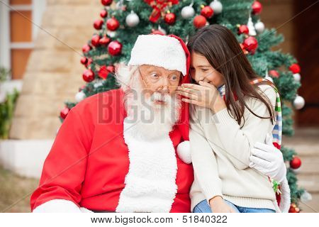 Shocked Santa Claus listening to girl's wish in front of Christmas tree