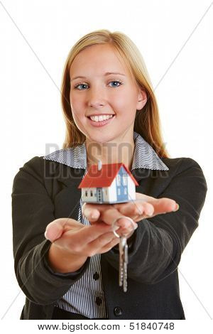 Young business woman with house and keys on her hands