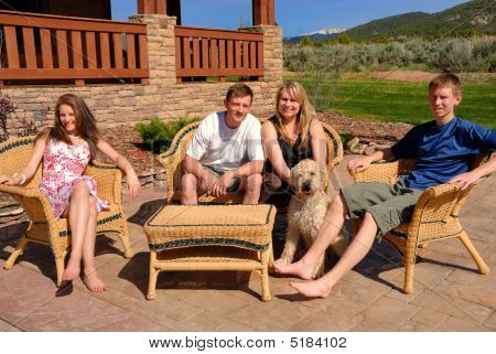 Family By Their Home