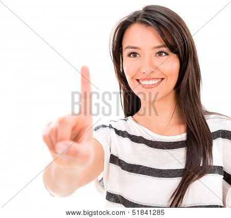 Woman pointing in from of her with her finger - isolated over white