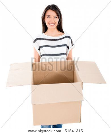 Happy woman moving and holding a box - isolated over white