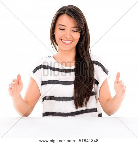 Woman holding something imaginary to edit - isolated over white