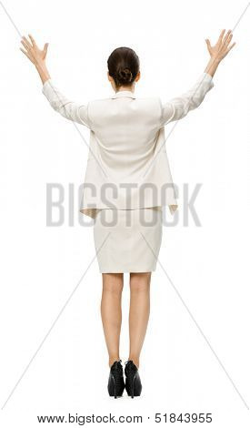 Full-length backview of businesswoman putting her hands up, isolated on white. Concept of leadership and success