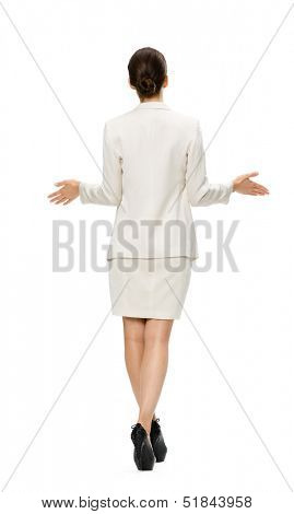 Full-length backview of business woman with outstretched arms, isolated on white. Concept of leadership and success