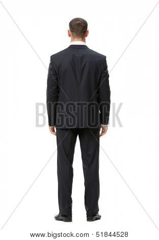 Full-length backview portrait of businessman, isolated on white. Concept of leadership and success