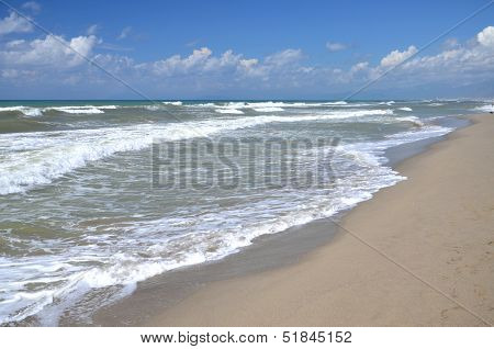 Restless sea on sandy beach Marina di Vecchiano nearby Pisa, Tuscany in Italy