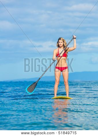 Attractive Young Woman Stand Up Paddle Surfing In Hawaii, Beautiful Tropical Ocean, Active Beach Lifestyle