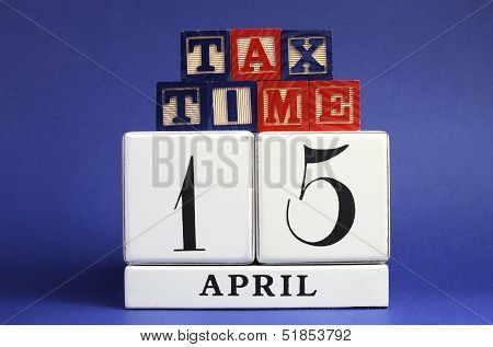 April 15 Calendar Date With Tax Time Message On Building Blocks For Tax Day Reminder.