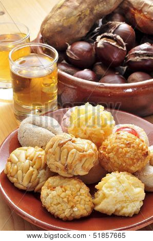 some panellets and roasted chestnuts and sweet potatoes, and sweet wine, typical snack in All Saints Day in Catalonia, Spain