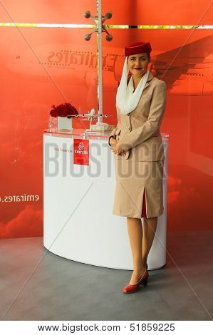 Emirates Airline flight attendant at the Emirates Airline booth at the US Open 2013