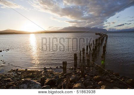Sunset At The Coastline Of Puerto Natales.