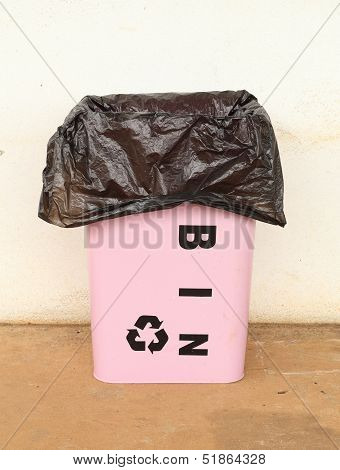 Trash Can With A Plastic Bag