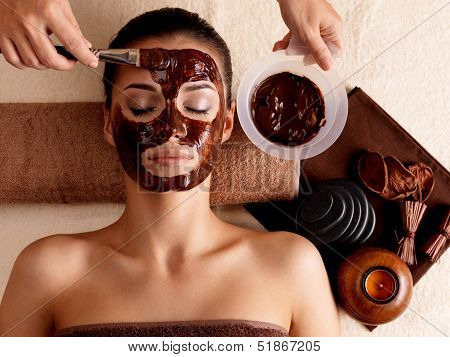 Spa Therapy For Woman Receiving Cosmetic Mask