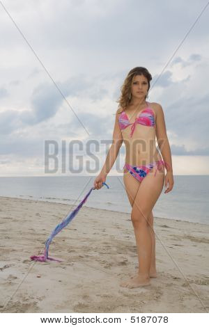 Pretty Blond Lady Wearing A Pink And Blue Bikini