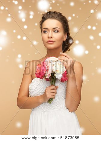 valentine's day, bridal, wedding, christmas, x-mas, winter, happiness concept - young woman with bouquet of flowers.