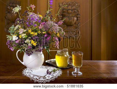 Still life from medicinal herbs, honey, herbal tea