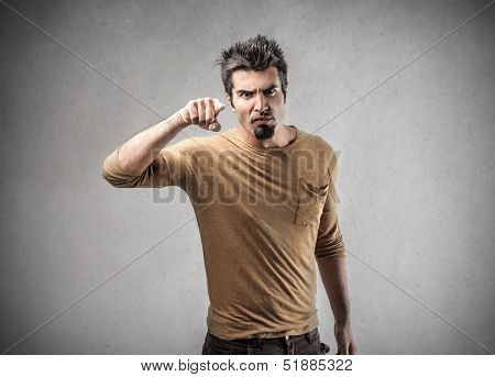 angry man pointing his finger accusing