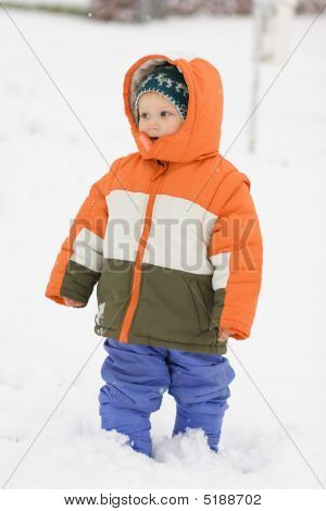 Boy Walking In Snow