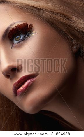 Close-up image of woman's eye with make-up