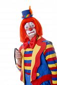 stock photo of droopy  - sad clown holding a sagging magic wand - JPG