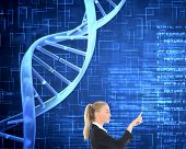 Composite image of blonde businesswoman pointing somewhere on blue background showing dna spiral