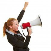 Angry business woman protesting with megaphone and clenched fist