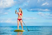 Attractive Young Woman Stand Up Paddle Surfing In Hawaii, Beautiful Tropical Ocean, Active Beach Lif