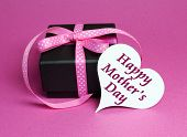 Special Small Black Box Present Gift With Pink Polka Dot Ribbon And White Heart Shape Gift Tag With