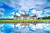 stock photo of symmetrical  - Chateau de Chambord royal medieval french castle and reflection - JPG