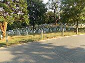 stock photo of arlington cemetery  - A beautiful sunset on the Arlington National Cemetery - JPG