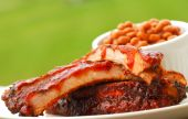 image of ribs  - Freshly grilled BBQ Ribs and beans in an outdoor setting - JPG