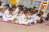 Young Children Pray In Tibetan Buddhist Monastery Sarnath