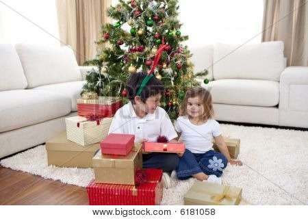 Happy Children Celebrating Christmas At Home
