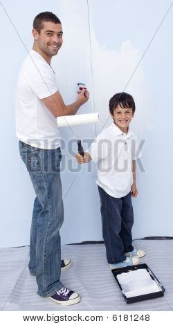 Man And Little Boy Painting A Wall