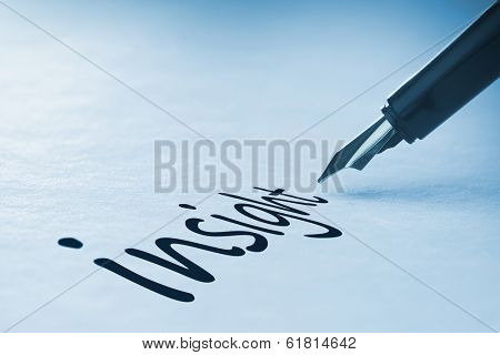 Fountain pen writing the word insight