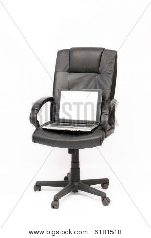 Open laptop on the black chair