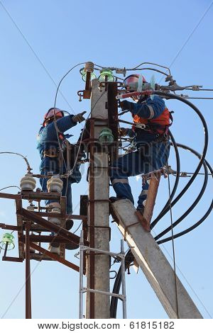 Electricians Working At Height