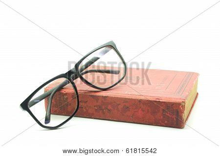 Old Book And Glasses Isolated On White