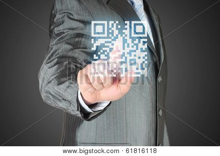 Businessman with hand pressing virtual qr code