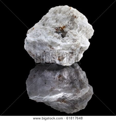 Albite mineral rock with reflection on black surface background