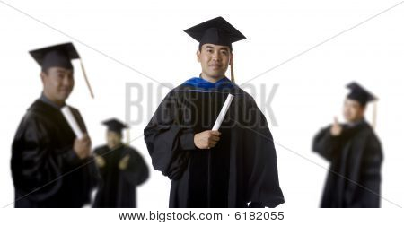 Graduate In Front Of Blurry Graduates