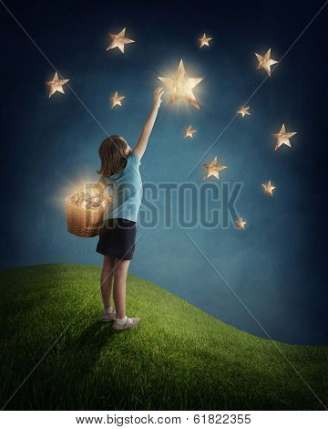 Little girl  trying to catch a star