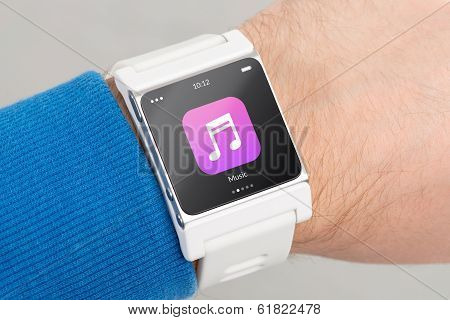 Close Up White Smart Watch With Music App Icon On The Screen