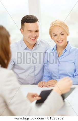 finance, bank, family and business concept - smiling couple at bank