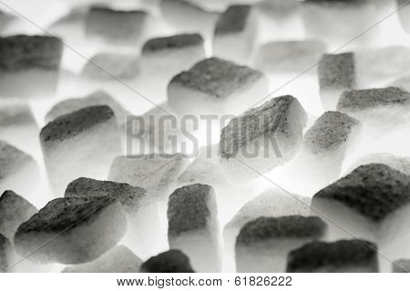 White sugar cubes lit from below.