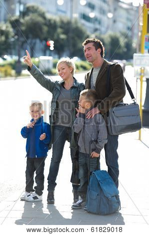 Family waiting for the bus, starting the working and school day